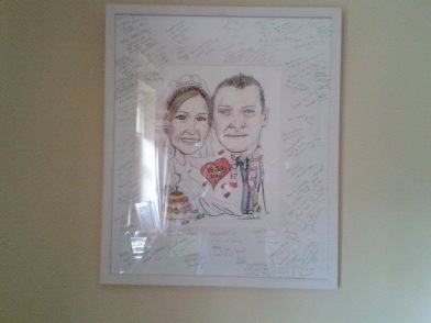 Lisa wedding guest board signed and hanging