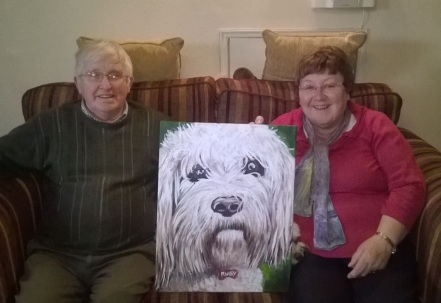 Happy customers, can you see Ruby peaking out behind her portrait