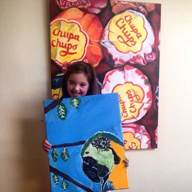 My Niece Bels went to Art camp.. I am so impressed with her Parrot, here she is in front of my Chupa Chups painting from about 10 years ago!